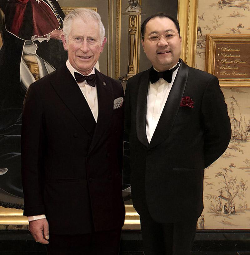 关毅先生向与英国查尔斯王储殿下